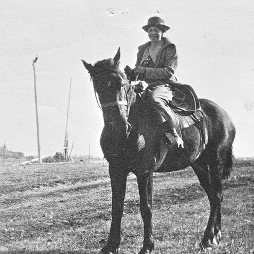 Catherine Donnelly on horseback in Saskatchewan